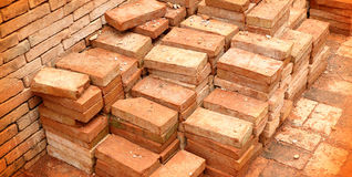 Pile of red clay bricks Royalty Free Stock Images