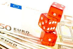 Pile of red dice on the 50-euro banknotes Stock Photo