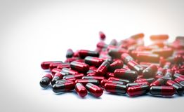 Pile of red and grey capsule pills isolated on white background with copy space. Flunarizine : drug for migraine prophylaxis Royalty Free Stock Photography