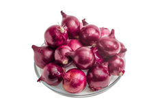 Pile of red onion on a glass dish Royalty Free Stock Photography