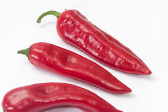 Pile of red paprikas on the white background Stock Photo