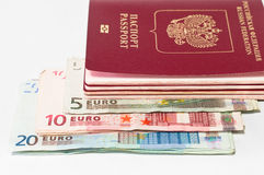 Pile of red passports and euro cash Stock Images