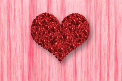 Pile of red rose in heart shape on pink background. Stock Photo