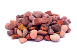 Pile of red stone. On white background Royalty Free Stock Photos
