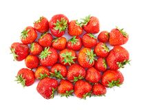 Pile of red strawberries isolated Stock Photo