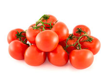 Pile of red tomato bunches over white background. Pile of red tomato bunches isolated over white background Royalty Free Stock Images