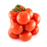 Pile of red tomato over white background. Pile of fresh red tomatoes isolated over white background Stock Image