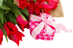 Pile of red  tulips with gift box Royalty Free Stock Photos