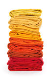 Pile of red and yellow folded clothes. Joyful laundry. Pile of red and yellow folded clothes on white background royalty free stock photos