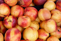 Pile of red and yellow peaches Stock Photo