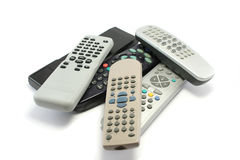 Pile of Remote Controllers. Various TV and video remote controls collecting dust around the house Royalty Free Stock Photography