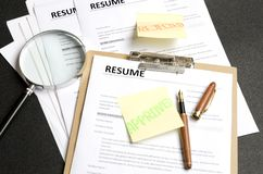 Lot of resume templates on black background.Recruiter making decision. Concept of reviewing resume applications stock photography