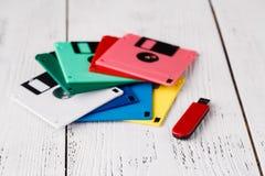 Pile of retro floppy disk versus usb flash driver Stock Image