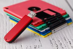 Pile of retro floppy disk versus usb flash driver Royalty Free Stock Photography