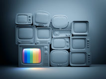 Pile of retro TV with one in standby - night scene. 3d illustration Royalty Free Stock Photo