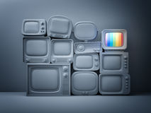 Pile of retro TV with one in standby - night scene. 3d illustration Stock Photos