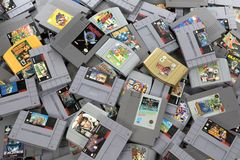 Pile of Retro Video Game Cartridges Stock Image