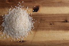 Pile of rice on the board Royalty Free Stock Photography