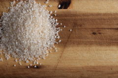 Pile of rice on the wooden board Royalty Free Stock Photos