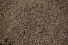 Pile of rich, healthy Compost Dirt. Close up view of rich, healthy compost dirt ready to be put into a garden and help grow healthy vegetables Royalty Free Stock Images