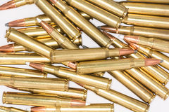 Pile of rifle bullets on white background Stock Image