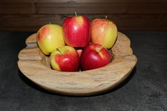 Pile of ripe apples in a wooden bowl. Torfhaus, Germany stock image