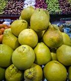 Pile of green Citrus grandis pomelo on Mediterranean market stock photos
