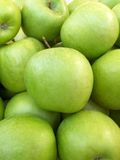 Pile of ripe green apples stock photography