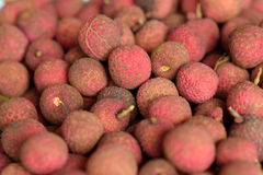 Pile of ripe lychees at the market. Pile of red ripe lychees at the market Royalty Free Stock Photos
