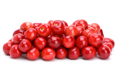 Pile of ripe red cherries. Isolated on the white background Stock Photos