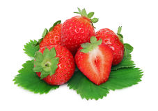 Pile of ripe strawberries with green leaves (isolated) Royalty Free Stock Photos