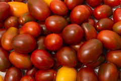 Pile of ripe tomatoes. (Cherry, Black Prince) on wooden background Stock Photos
