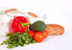 Pile of ripe vegetables and baguette in paper bag Royalty Free Stock Image