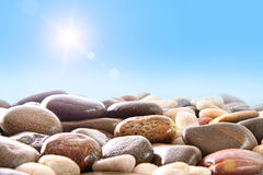 Pile of river rocks on white Royalty Free Stock Image