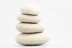 Pile of river stones. On white background Royalty Free Stock Photos
