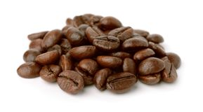 Pile of roast coffee beans. Isolated on white Stock Images