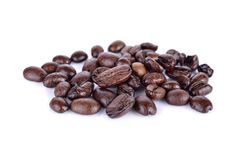 Pile of roasted coffee beans arabica strong blend on white backg. Pile of roasted coffee beans arabica strong blend on a white background Stock Photos