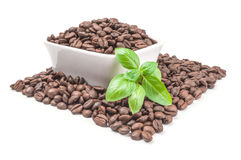 Pile of roasted coffee beans isolated on a white background cutout. Roast coffee on a white background. Clipping path Royalty Free Stock Photo