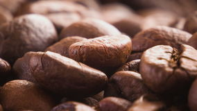 A pile of roasted coffee beans rotating stock video footage