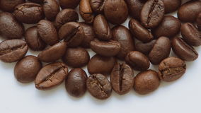 A pile of roasted coffee beans rotating. Close up stock video footage