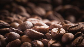 A pile of roasted coffee beans rotating. Close up stock video