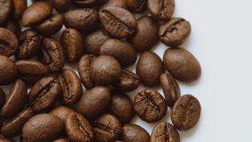 A pile of roasted coffee beans rotating. Close up stock footage