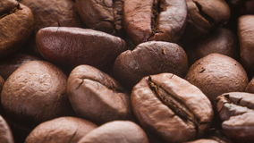 A pile of roasted coffee beans rotating stock video