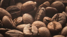 A pile of roasted coffee beans rotating stock footage