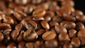 A pile of roasted coffee beans rotating. Close up.  stock footage