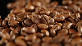 A pile of roasted coffee beans rotating. Close up.  stock video