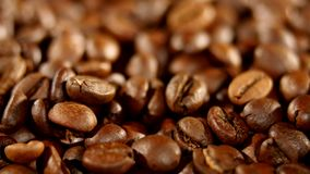 A pile of roasted coffee beans rotating. Close up.  stock video footage
