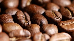 Pile of roasted coffee beans rotating. Close up. Pile of roasted coffee beans rotating, rotation of aromatic roasted coffee beans, coffee bean background, coffee stock video footage