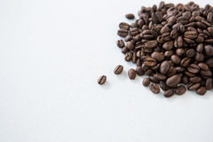 Pile of roasted coffee beans. On white background Royalty Free Stock Photo