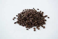 Pile of roasted coffee beans. On white background Royalty Free Stock Image